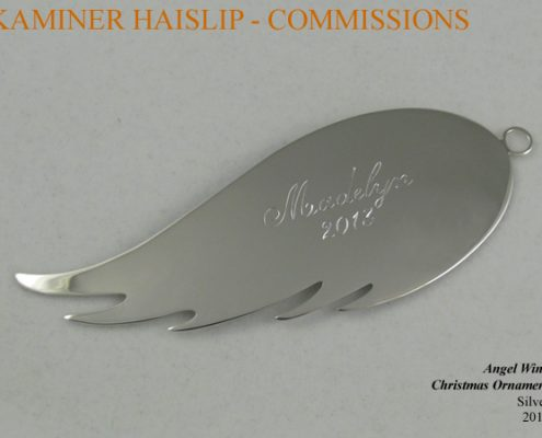 The design for this Christmas ornament was inspired by an angel wing. The name and date were hand engraved.