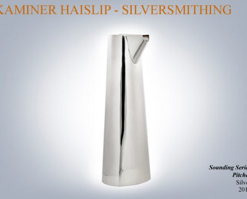 This silver pitcher is part of a series based on rounded triangle forms.