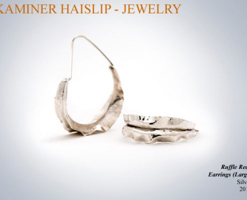 These silver earrings were created by utilizing the traditional silversmithing technique of fold forming.